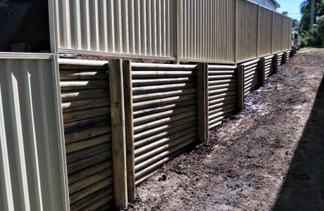 Treated Pine log wall & Colorbond fence - Southport, Gold Coast - Australian Retaining Walls 1